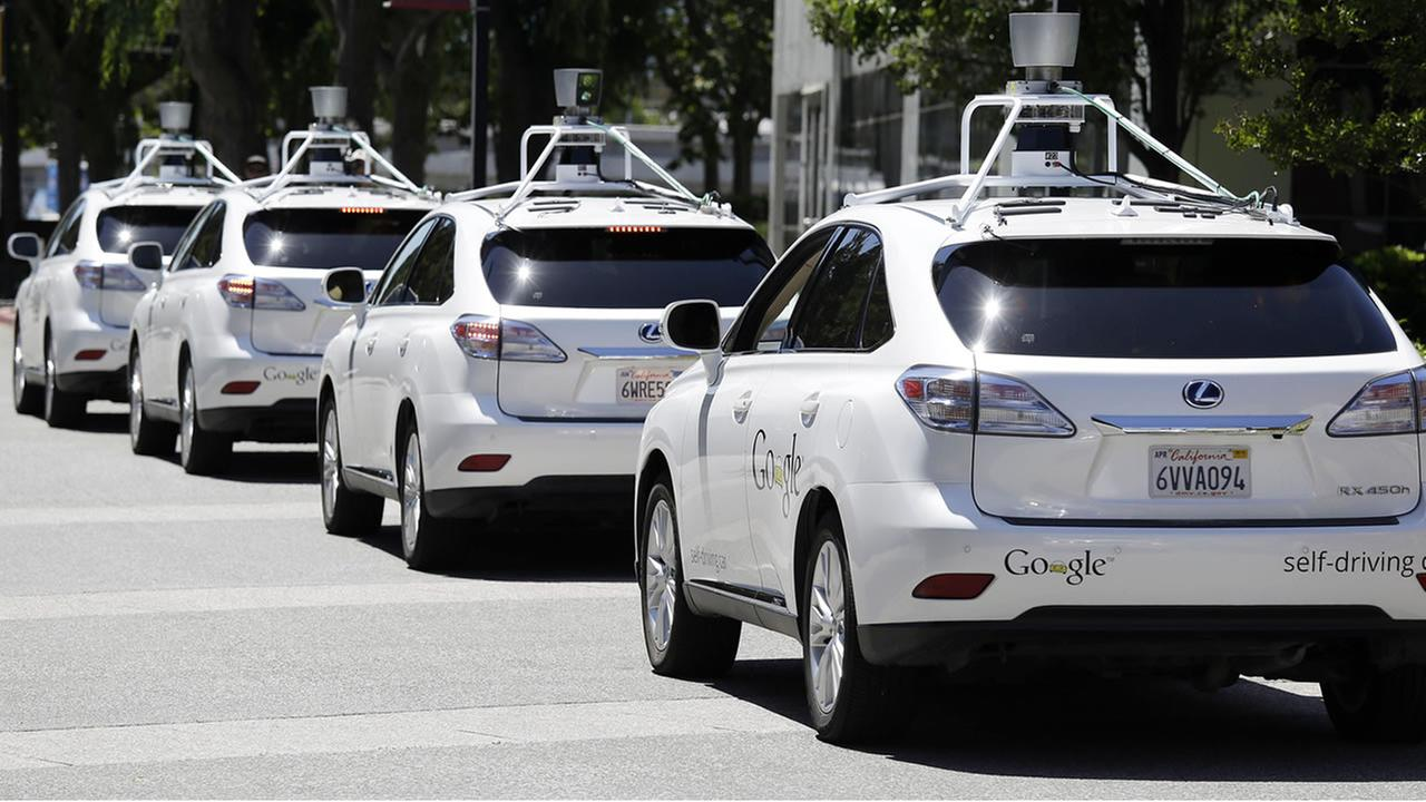 This May 13, 2014, file photo shows a row of Google self-driving Lexus cars (AP Photo/Eric Risberg, File)