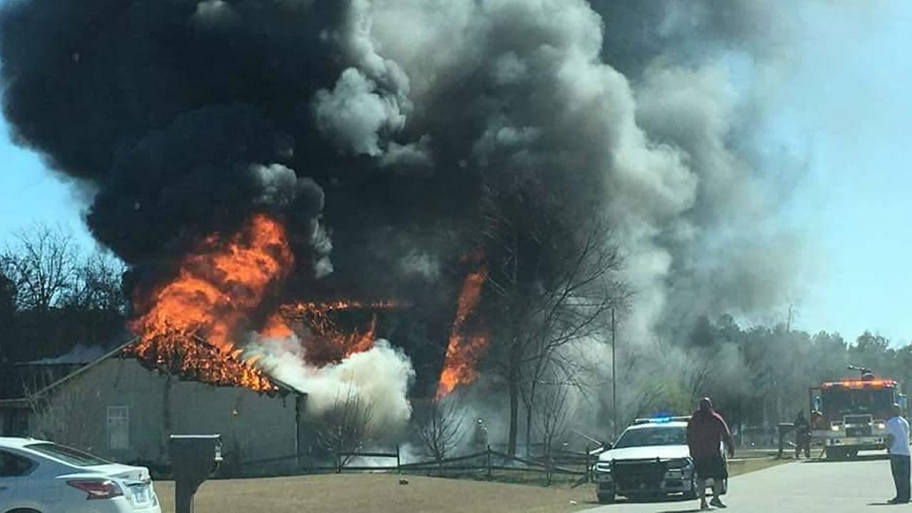 Smoke and flames poured from the home (image courtesy Hoke County Sheriffs Office)