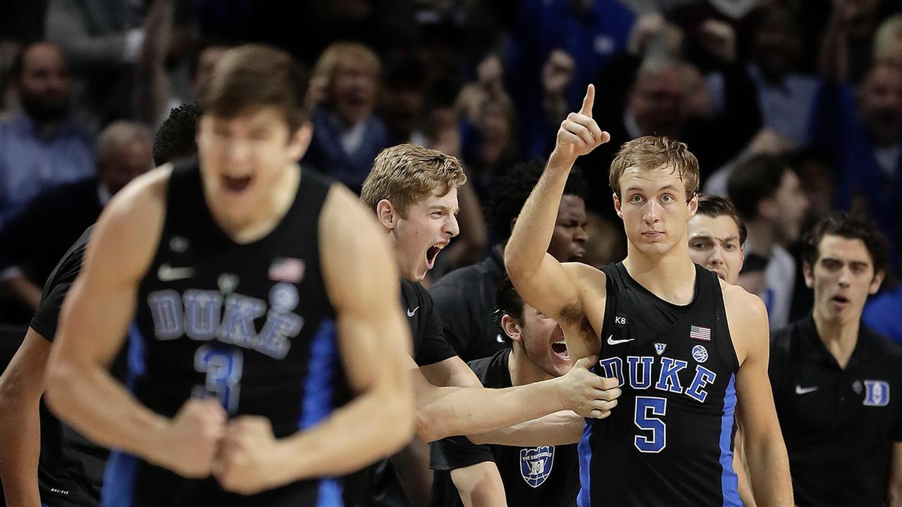 Grayson Allen, foreground, and Luke Kennard are pumped as the Blue Devils seize the momentum down the stretch against UNC on Friday night.