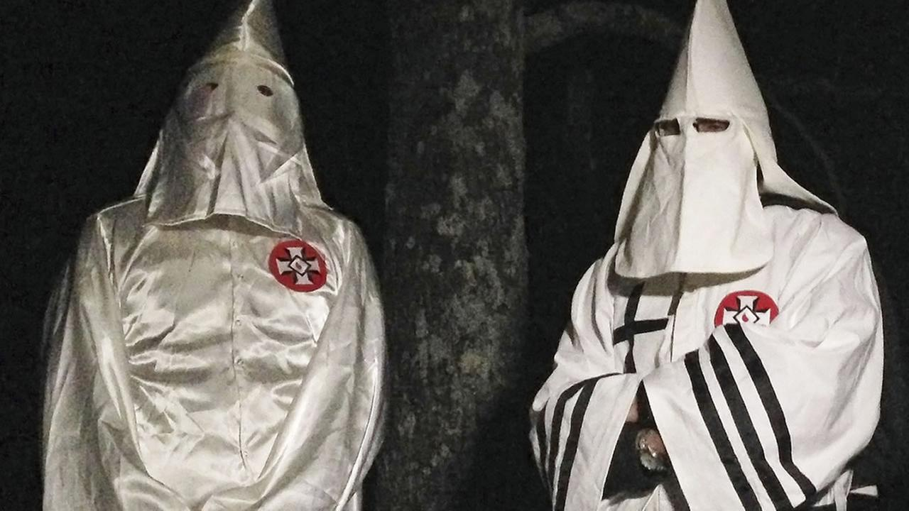 Two masked Ku Klux Klansmen during an interview near Pelham, N.C. (AP Photo/Jay Reeves)