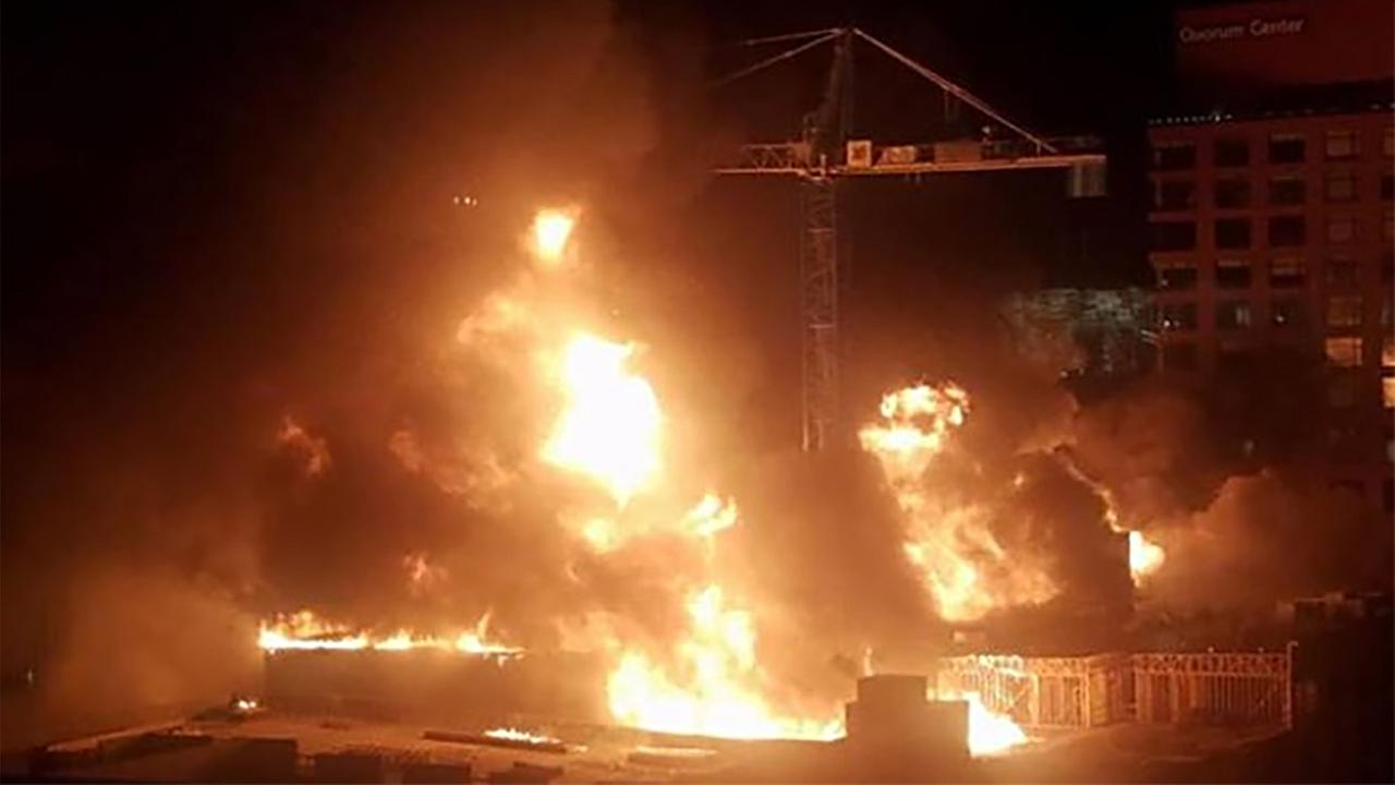 A building under construction became engulfed in flames in downtown Raleigh.Lori Denberg