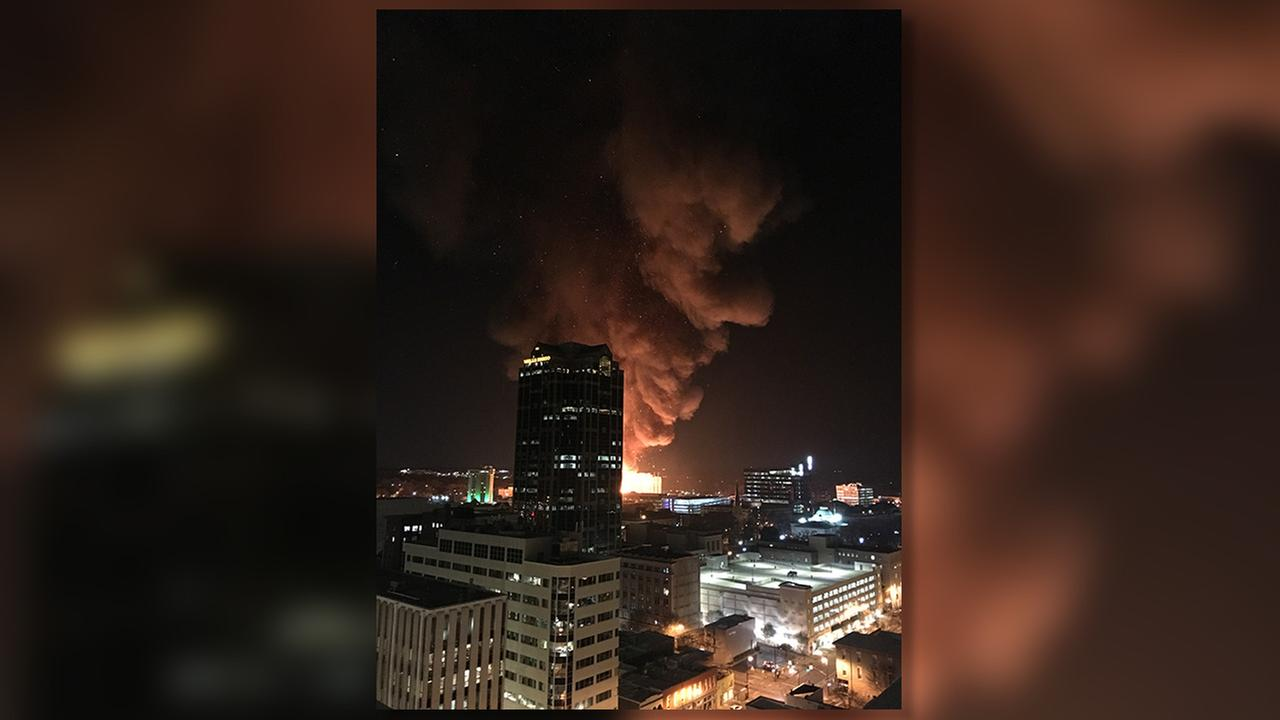 The Wells Fargo tower is visible as the fire burns.