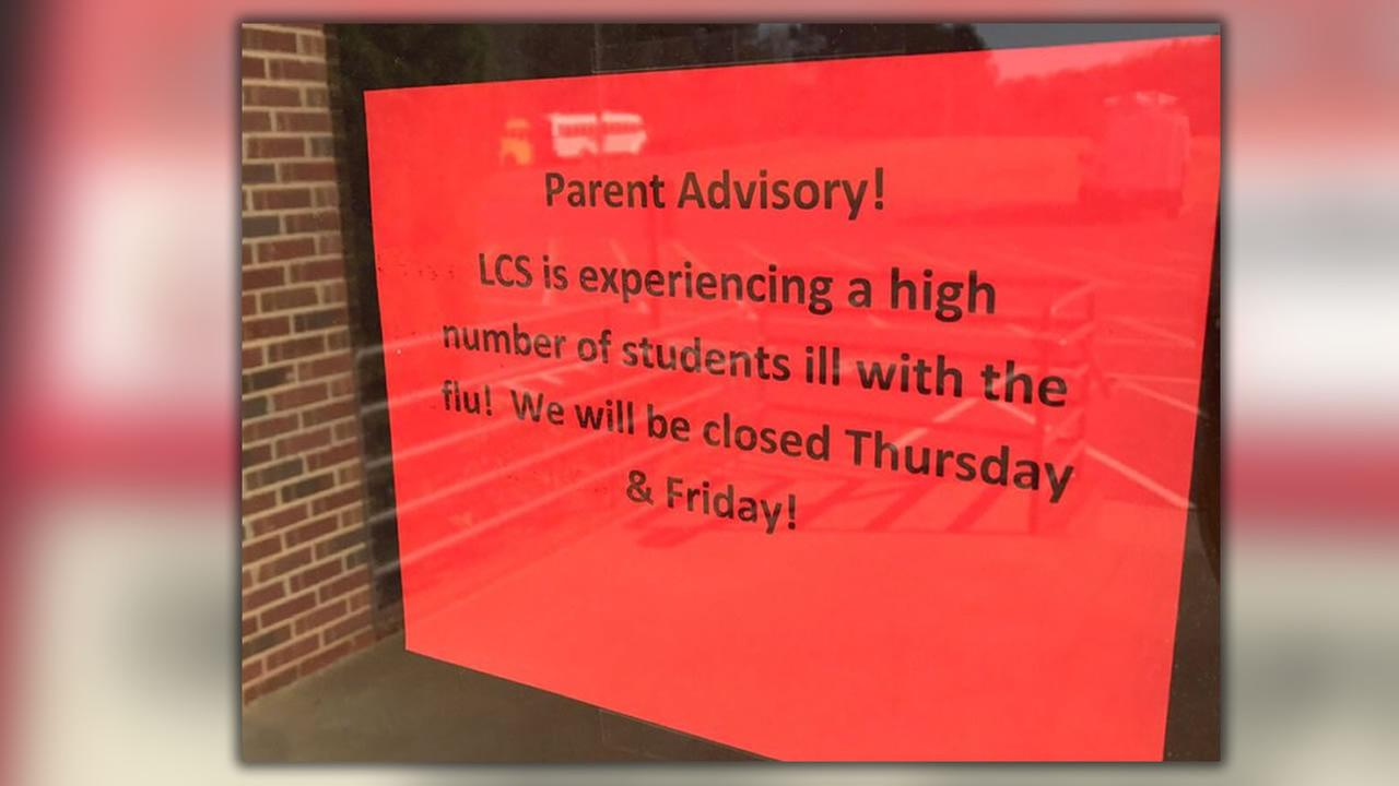 A sign on the door at Lee Christian School