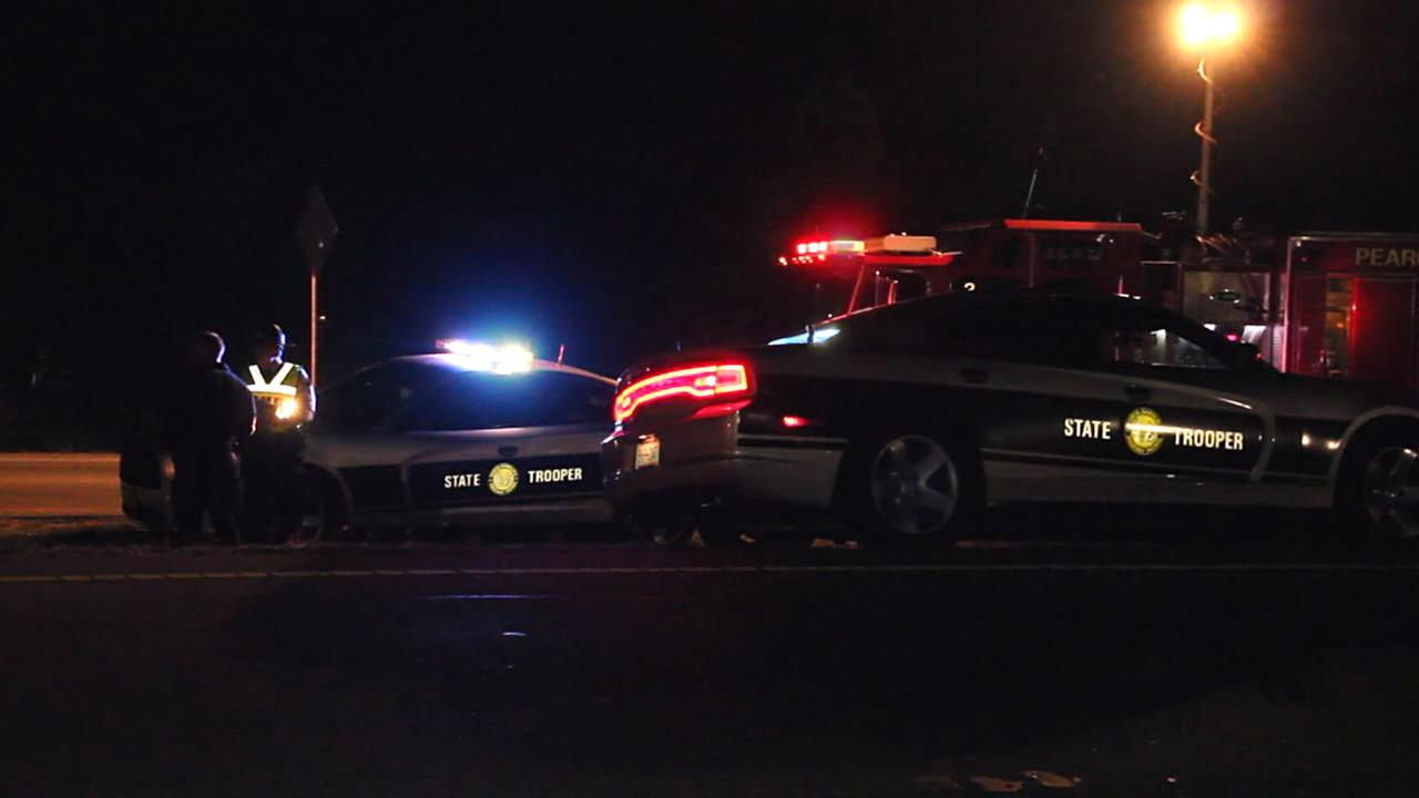 State troopers investigate the scene of the fatal pedestrian accident.