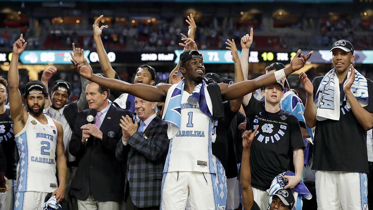 Theo Pinson (1) and the rest of the Tar Heels celebrate their national title.
