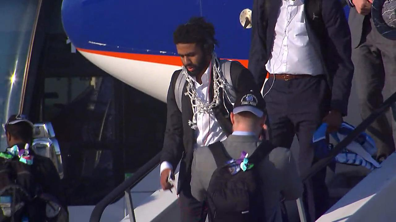 Joel Berry II arrives with the net around his neck Tuesday after the NCAA title victory Monday.