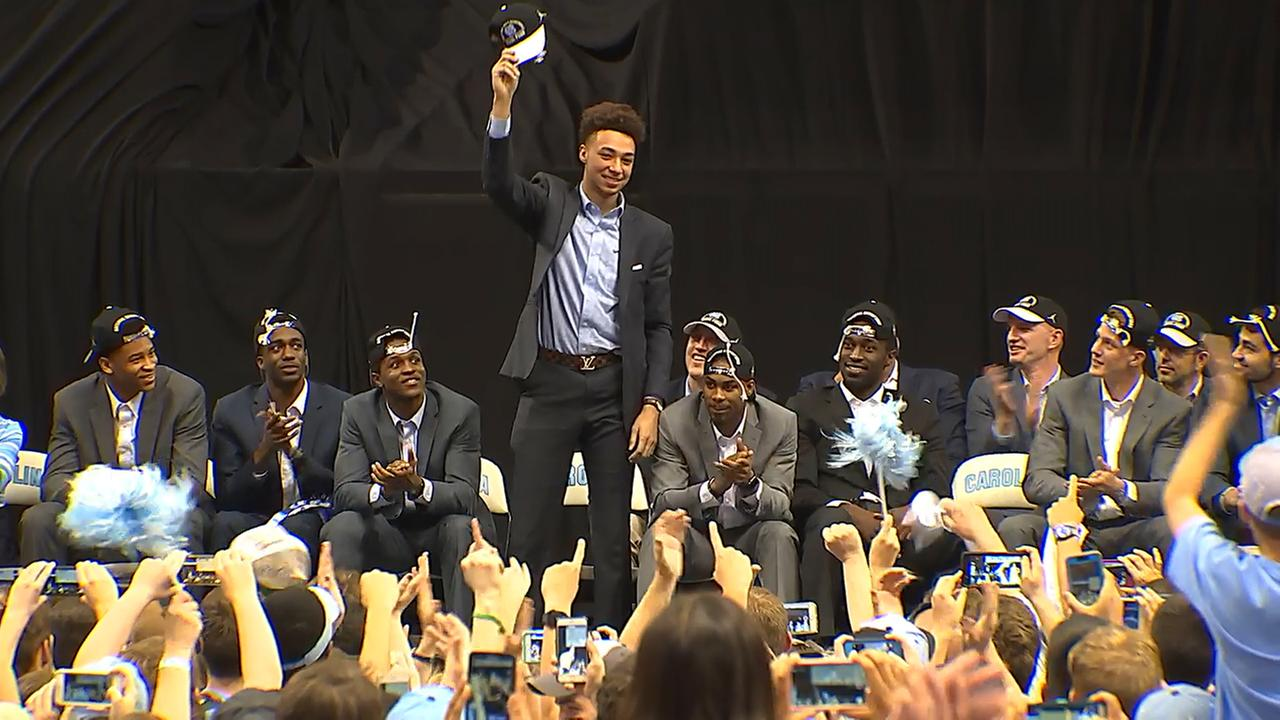 Tar Heels players take the stage at the Dean Dome on Tuesday evening.