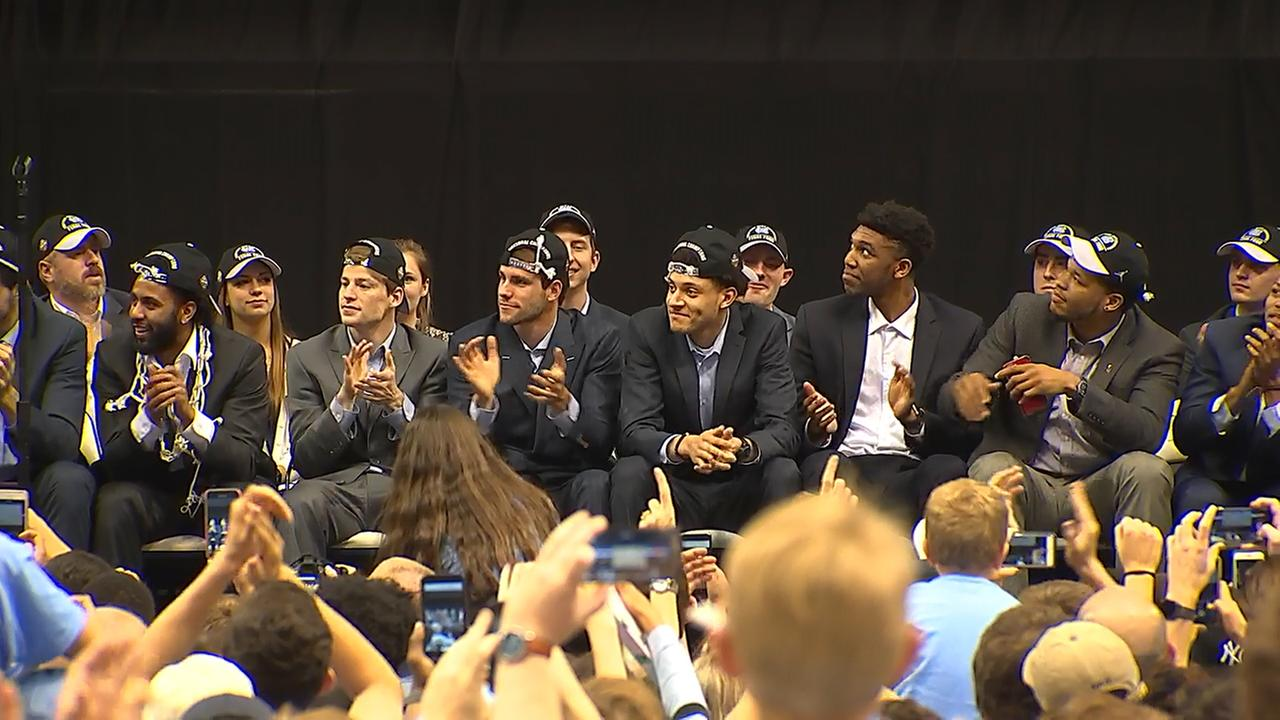 Tar Heels players on the stage.