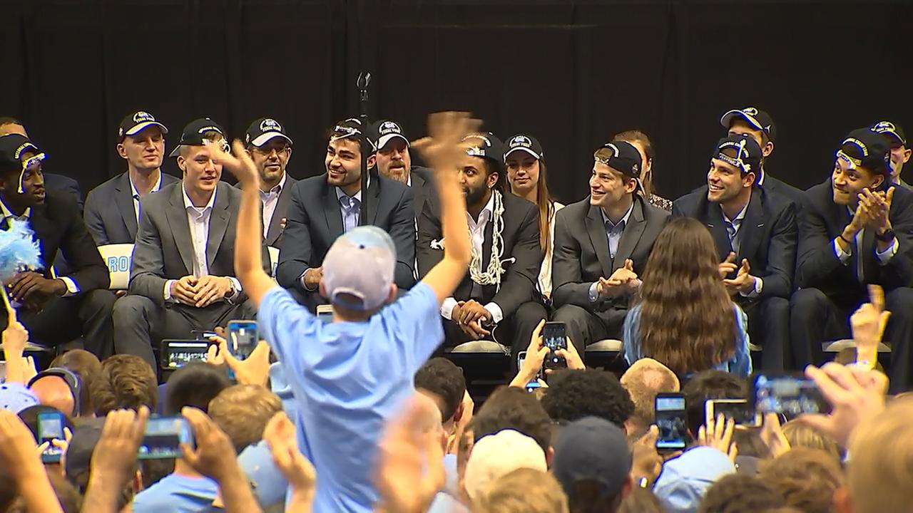Tar Heel players on the stage at the Dean Dome.