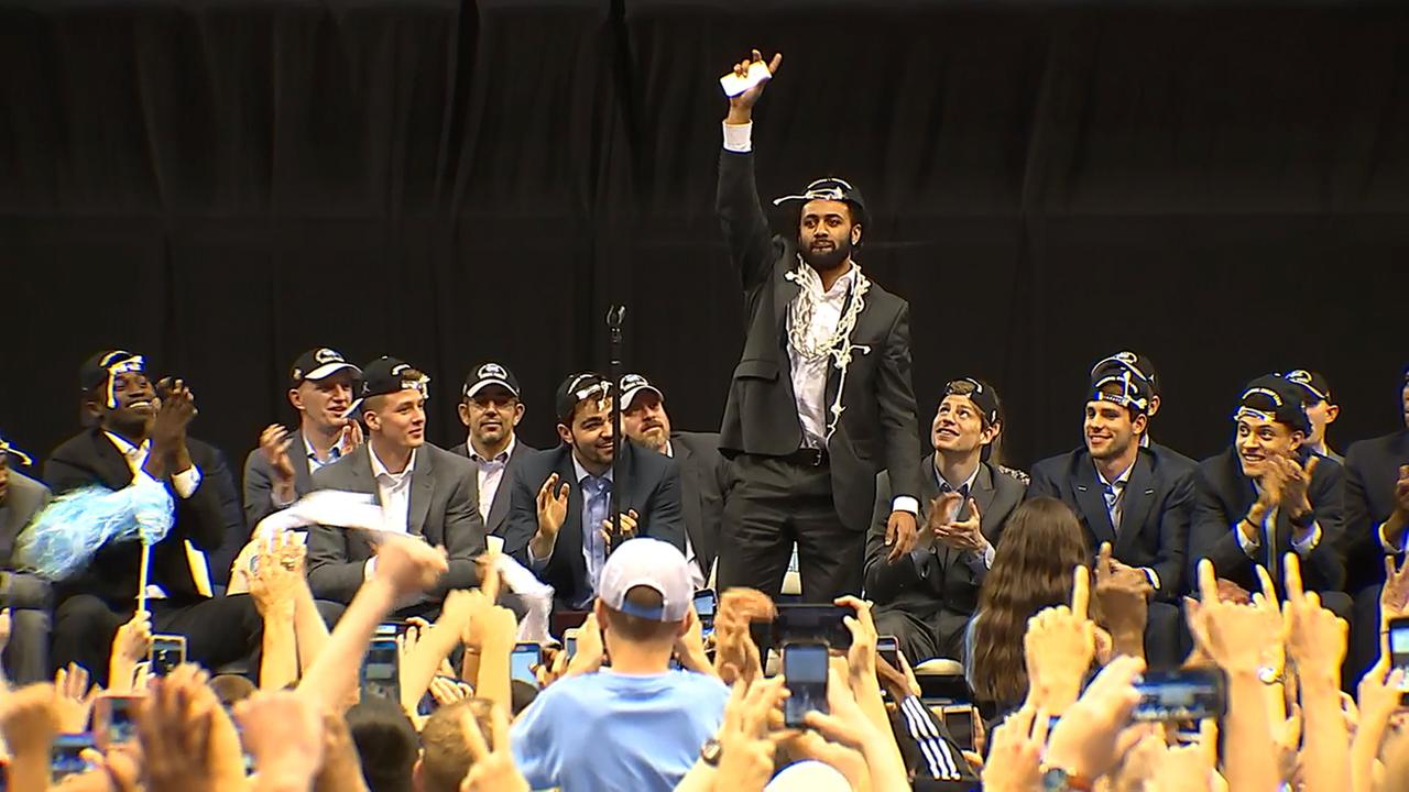 Joel Berry II, with the title net still around his neck, waves to the crowd at the Dean Dome on Tuesday.