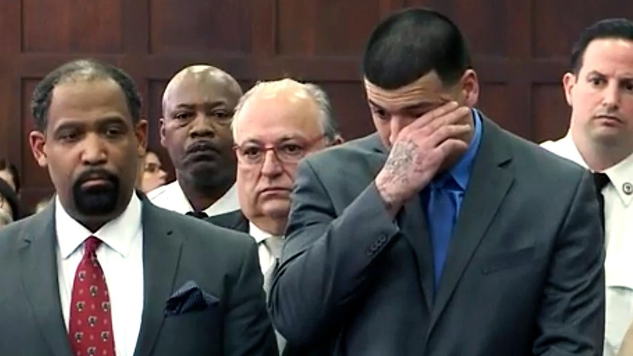 Aaron Hernandez wipes away a tear as he is acquitted Friday in the 2012 double slaying.