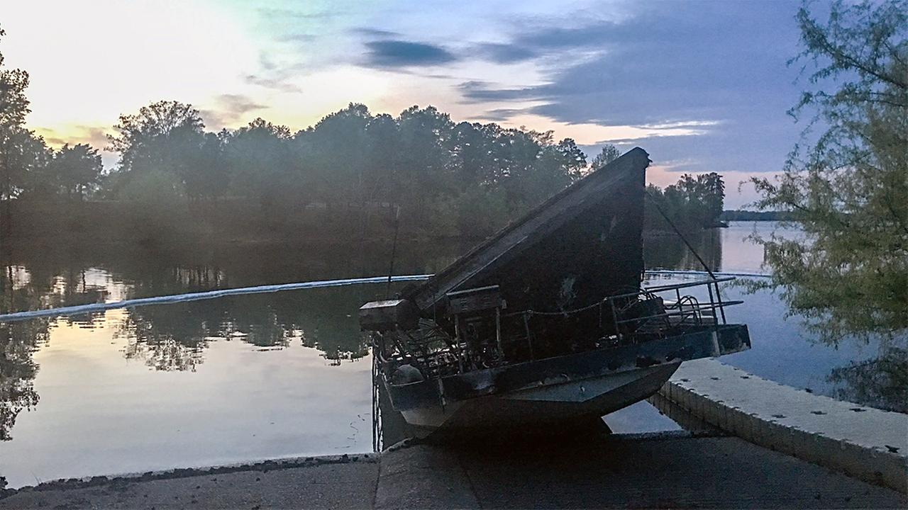 Three boats were charred by a fire at the Kerr Lake marina on Thursday night.Angelica Alvarez