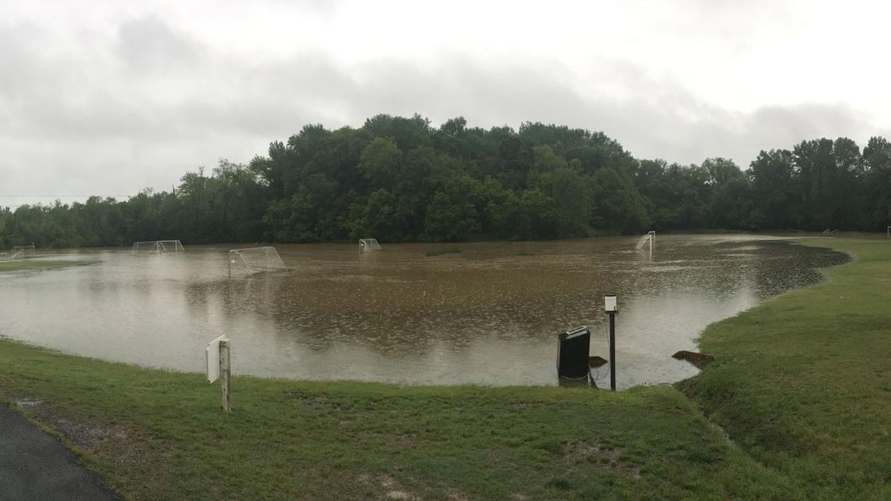 Woodcroft Swim and Tennis Club in south Durham. Much of the soccer field is underwater