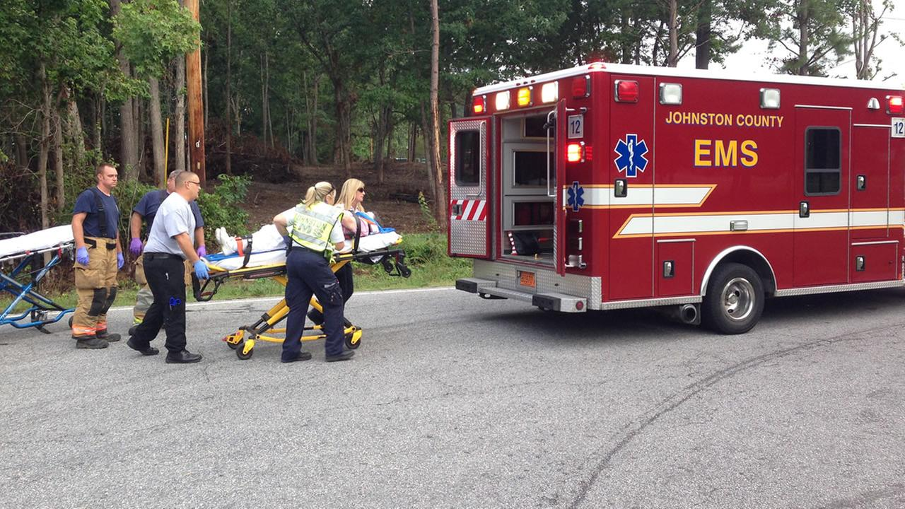 Emergency workers help the injured in a wreck at Barber Mill Rd. and Dairy Rd.