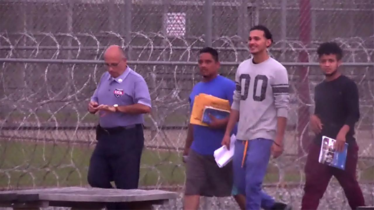 Ruben Guzman, in the 00 shirt, walks to freedom Friday at Stewart Detention Center in Georgia.