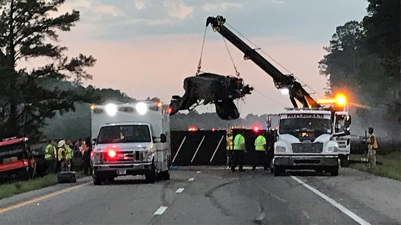 Wrecker crews remove charred and mangled wreckage from the I-95 crash on Tuesday evening.Greg Barnes