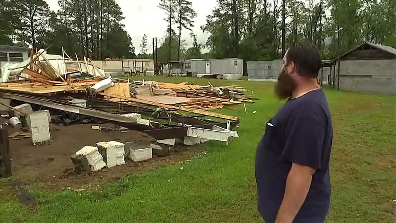 A resident looks at damage in his neighborhood.