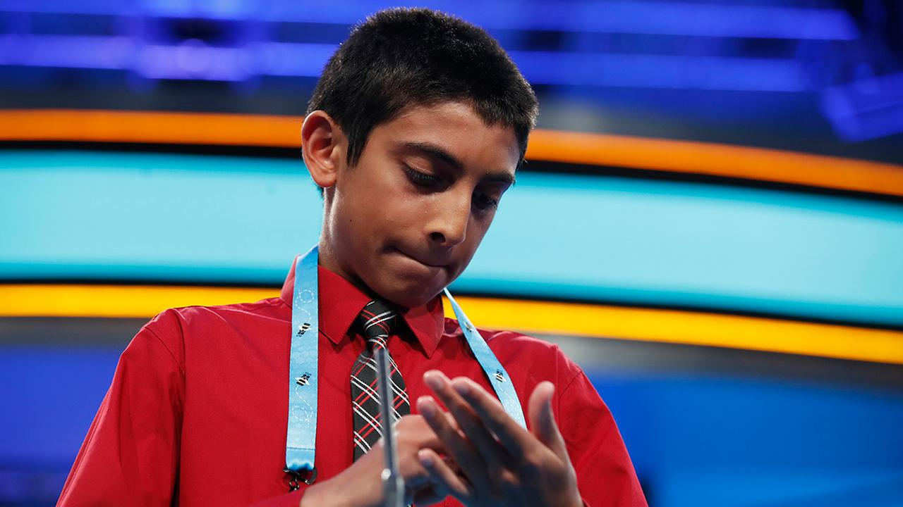 Rohan Sachdev spells a word Thursday night during the finals of the 90th Scripps National Spelling Bee, in Oxon Hill, Md.