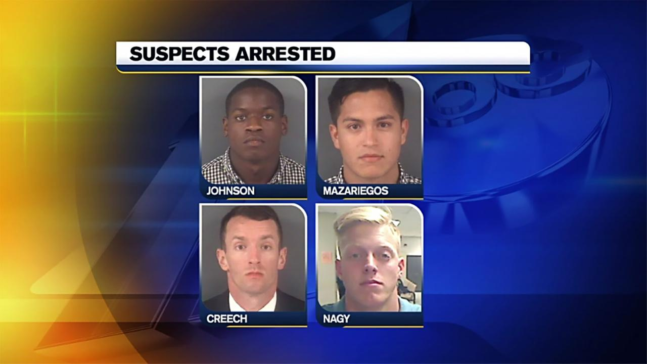 The four soldiers are charged in a secret-peeping case.