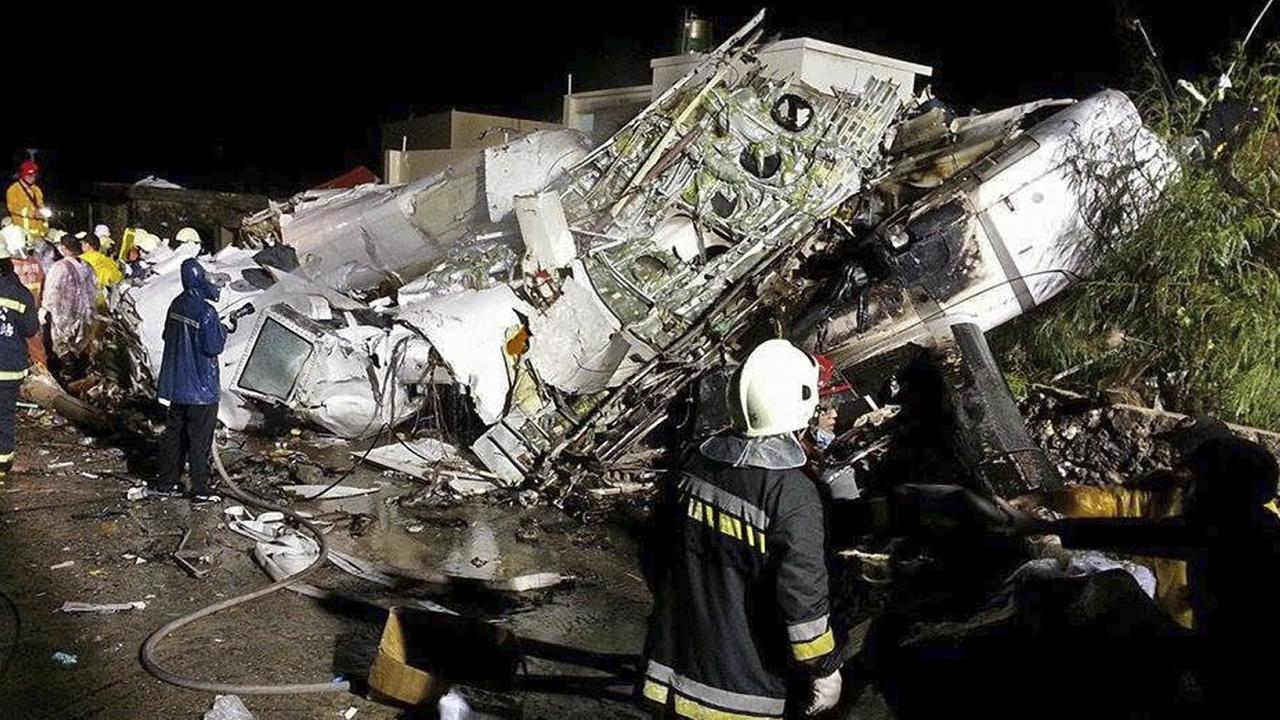 Rescue workers survey the wreckage of TransAsia Airways flight GE222. (AP Photo/Wong Yao-wen)