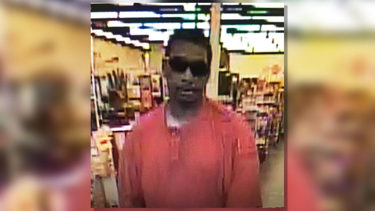 This unidentified armed robbery suspect in the surveillance image is considered armed and dangerous.