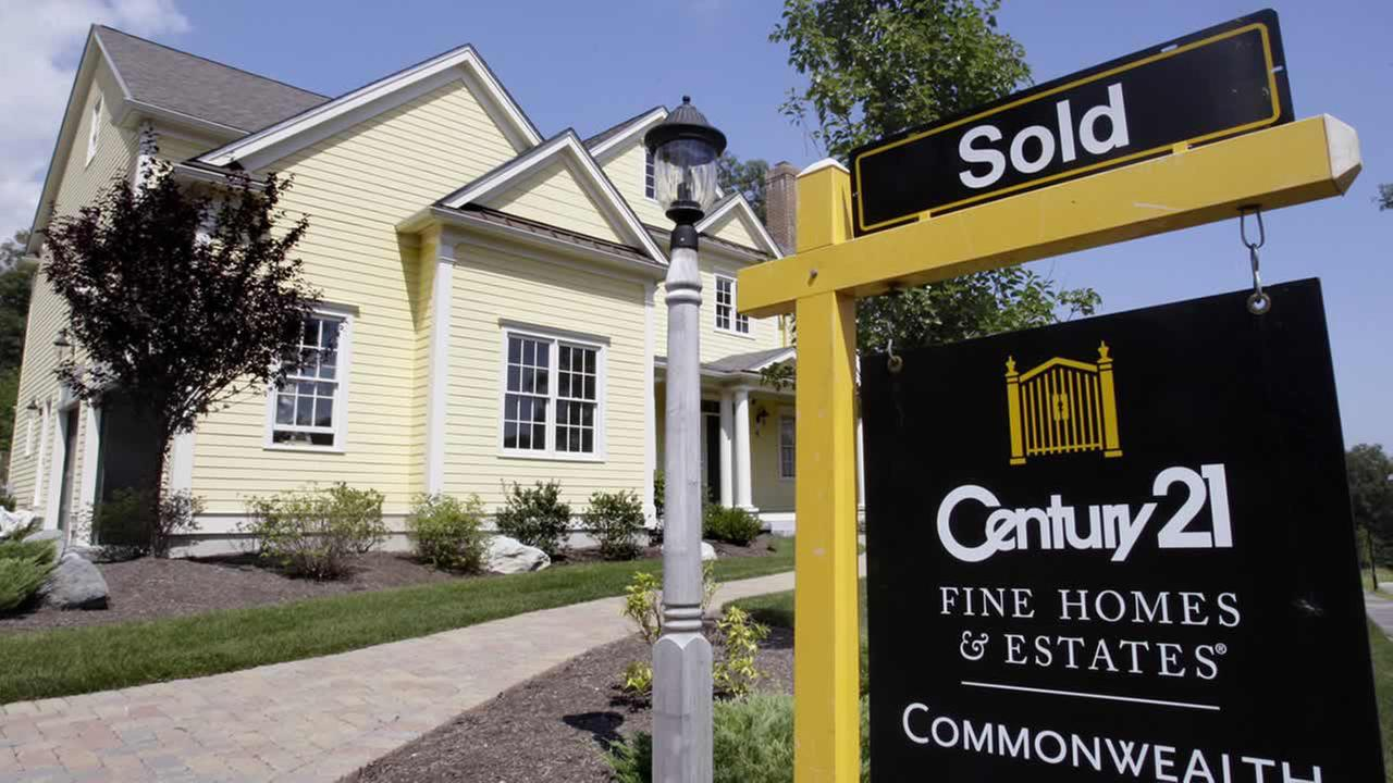 A sold sign is posted outside a newly constructed luxury home in Wellesley, Mass., Tuesday, Aug. 25, 2009.