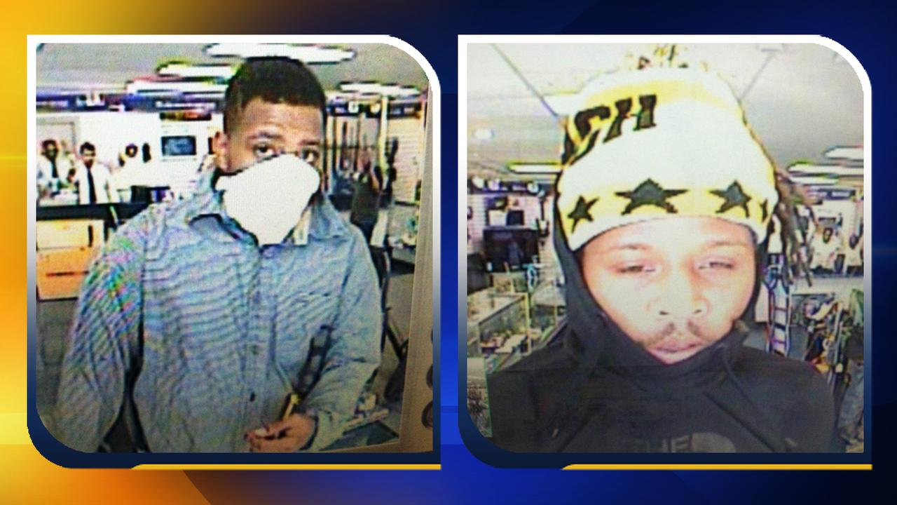 Surveillance images of two pawn-shop robbery suspects.
