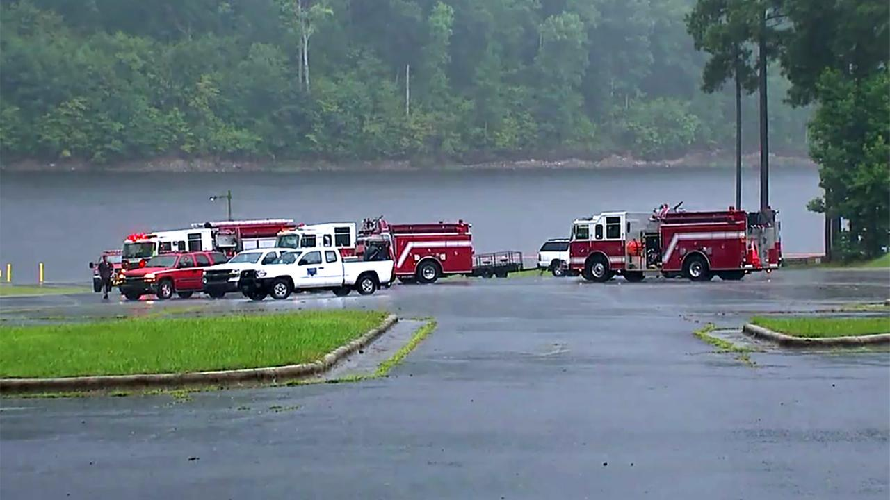 Authorities searched Falls Lake on Friday for a possible drowning victim.