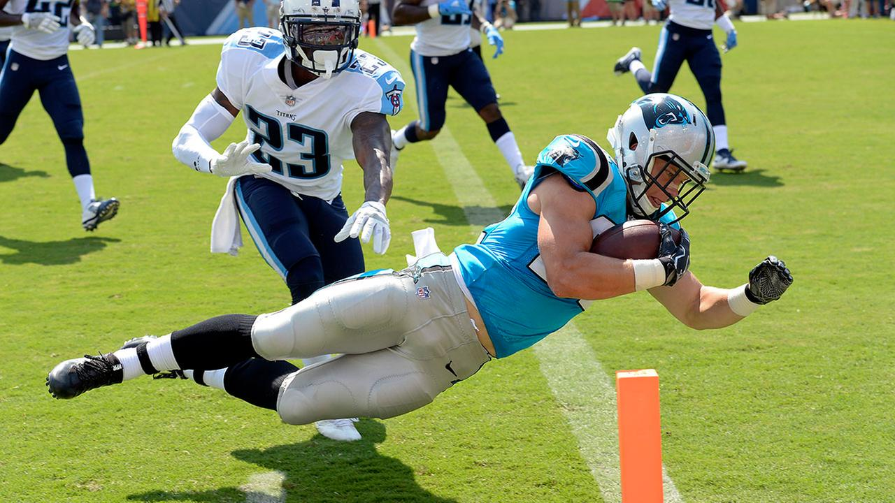 Carolina Panthers running back Christian McCaffrey dives into the end zone for a touchdown on a 17-year run.