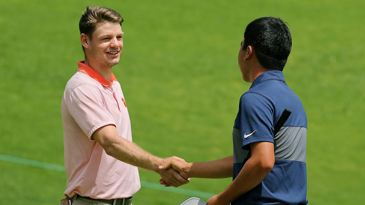 Doc Redman, left, shakes hands with Doug Ghim on the 18th hole Sunday.
