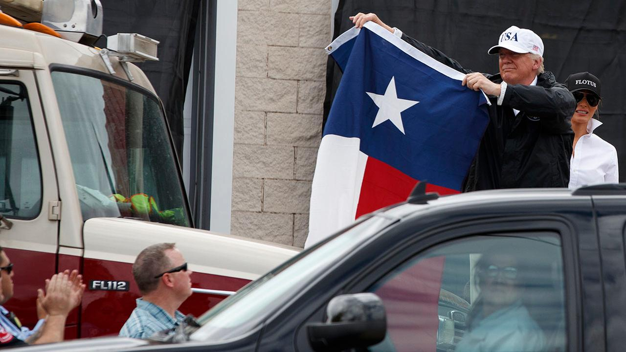 President Donald Trump holds up a Texas flag Tuesday in Corpus Christi, Texas.