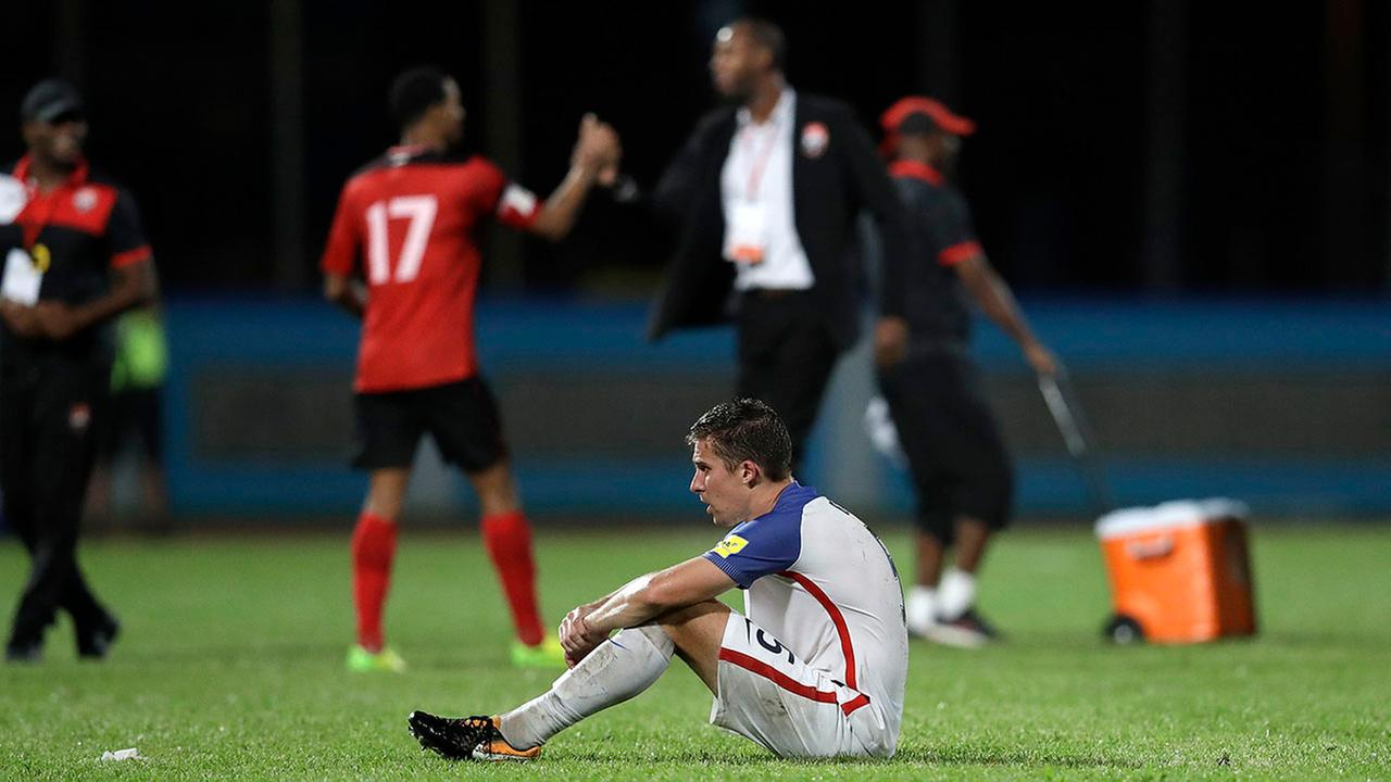 United States Matt Besler squats on the pitch in disbelief after losing 2-1 at Trinidad and Tobago on Tuesday.