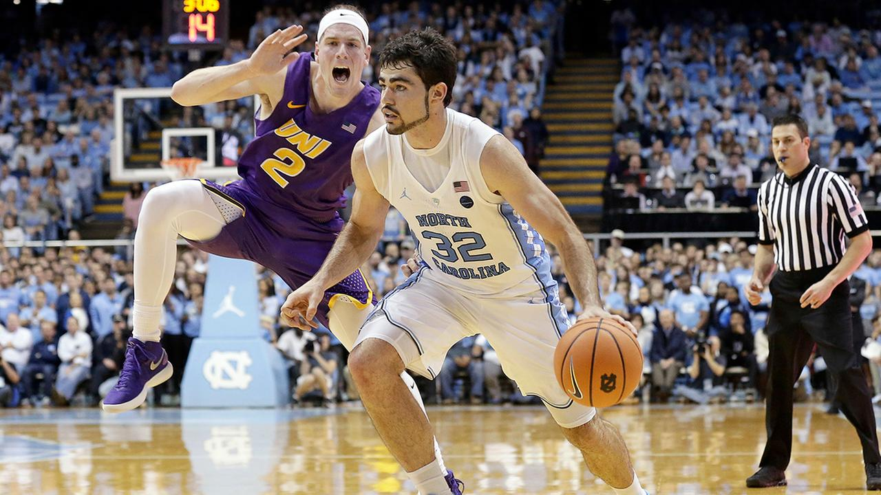 North Carolinas Luke Maye dribbles past Northern Iowas Klint Carlson on Friday.