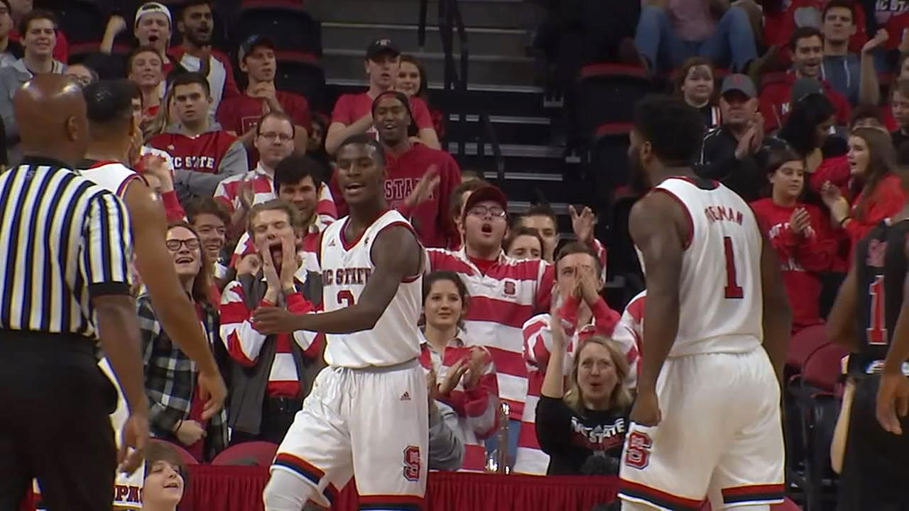 NC States Lavar Batts is fired up after a driving score as Lennard Freeman looks on Friday.