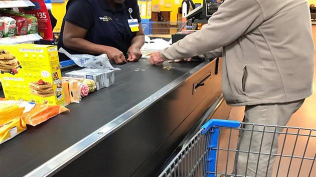 Walmart cashier helps man struggling to count change