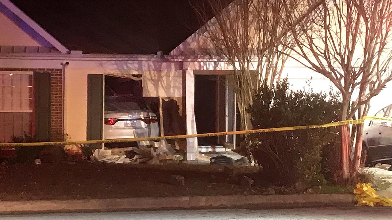 A car crashed into an Apex home.