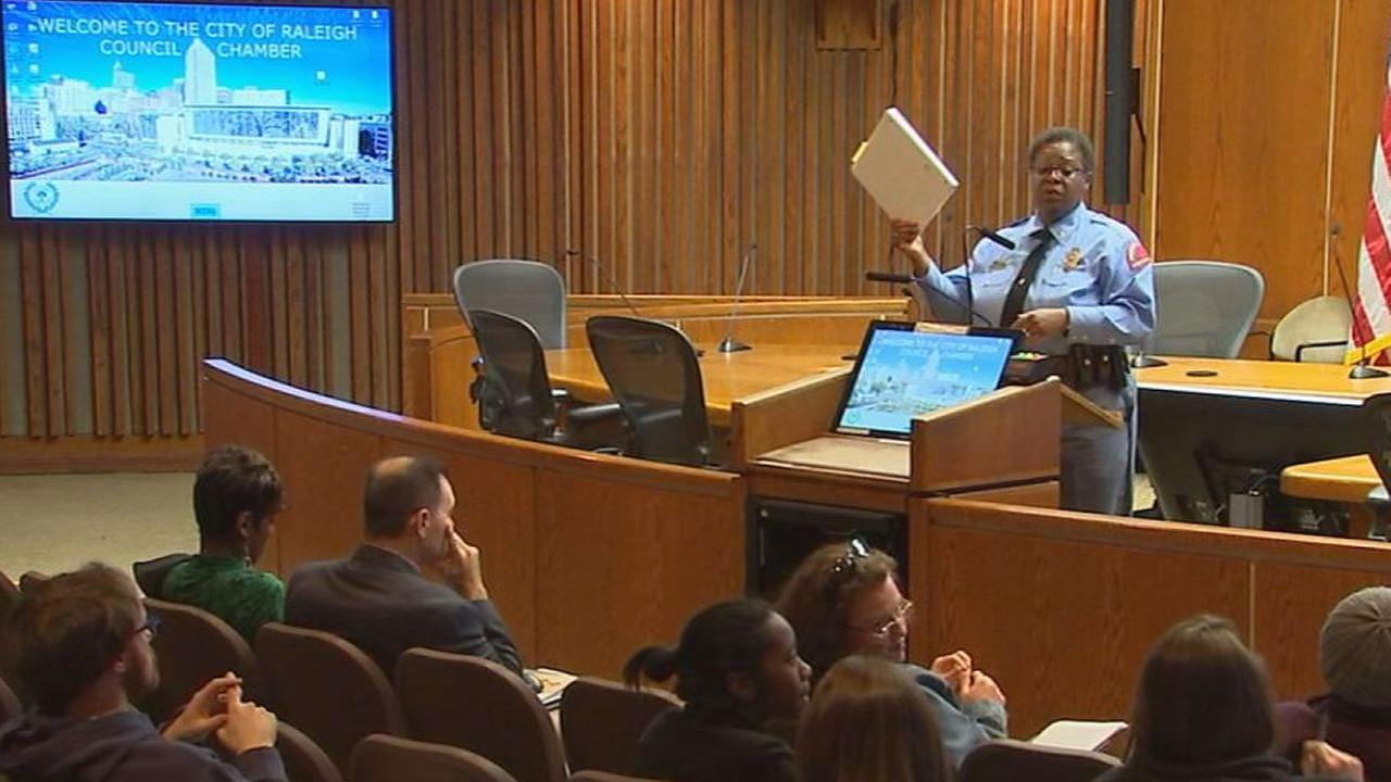 Raleigh Police Chief Cassandra Deck-Brown read the body camera draft to the crowd.