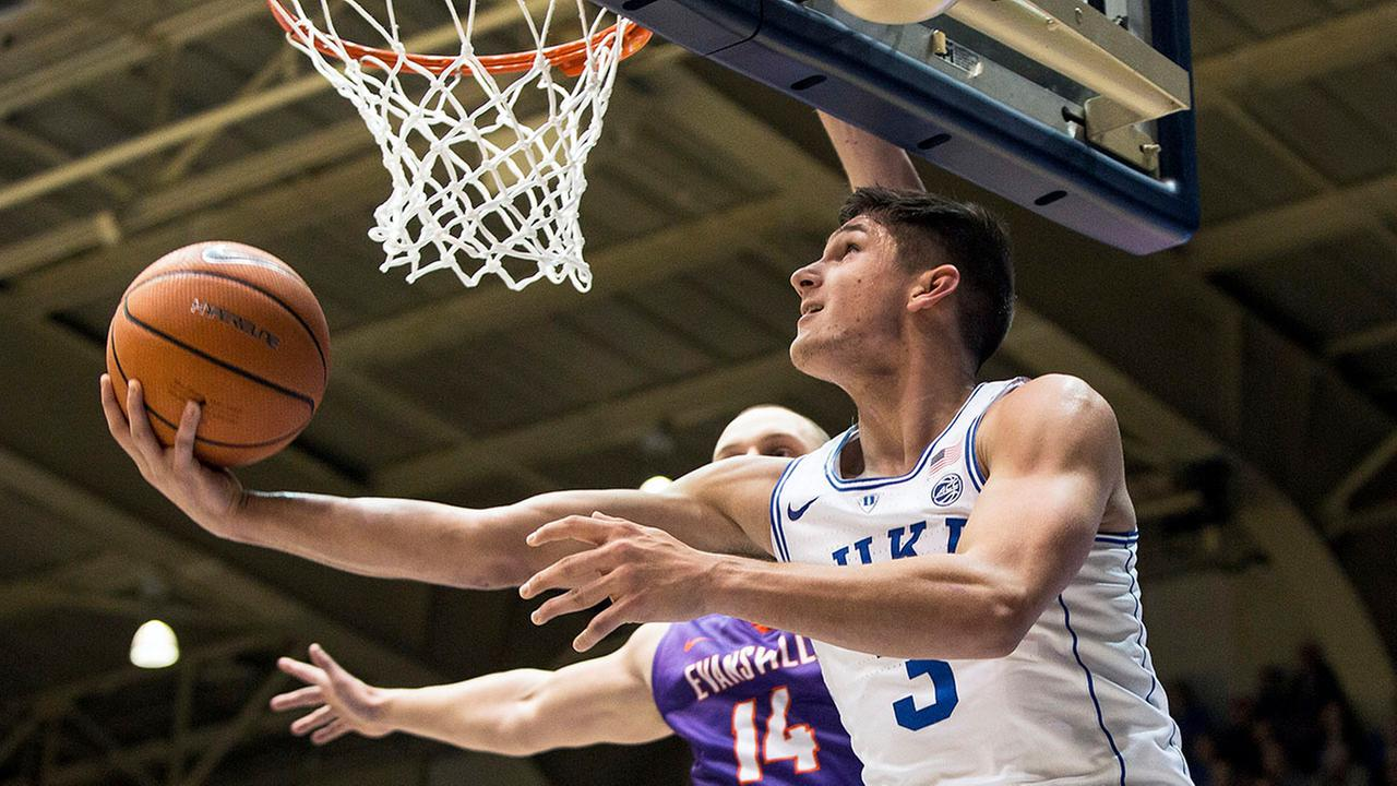 Dukes Grayson Allen slices in for a layup as Evansvilles Dainius Chatkevicius defends Wednesday in Durham.
