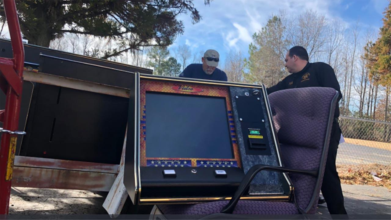Cumberland County deputies remove machines from a business on Wednesday.