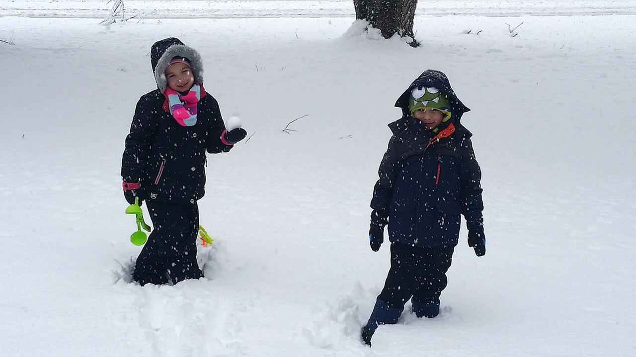 Adelina and Anthony playing in the snow!