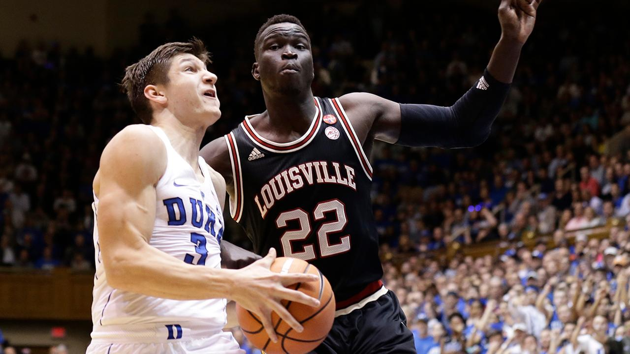 Dukes Grayson Allen drives to the basket against Louisvilles Deng Adel on Wednesday in Durham.