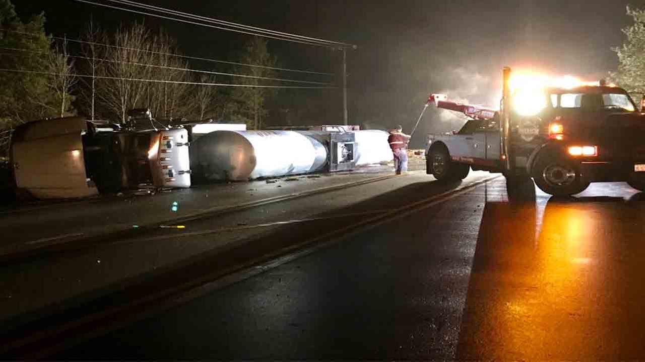 Liquid asphalt truck flips over, causes back up on Creedmoor Road in Raleigh