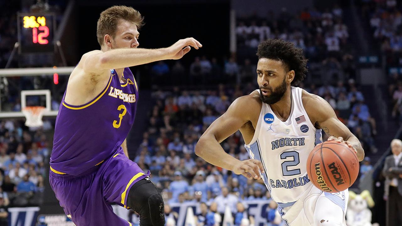 North Carolinas Joel Berry II drives against Lipscombs Michael Buckland on Friday in Charlotte
