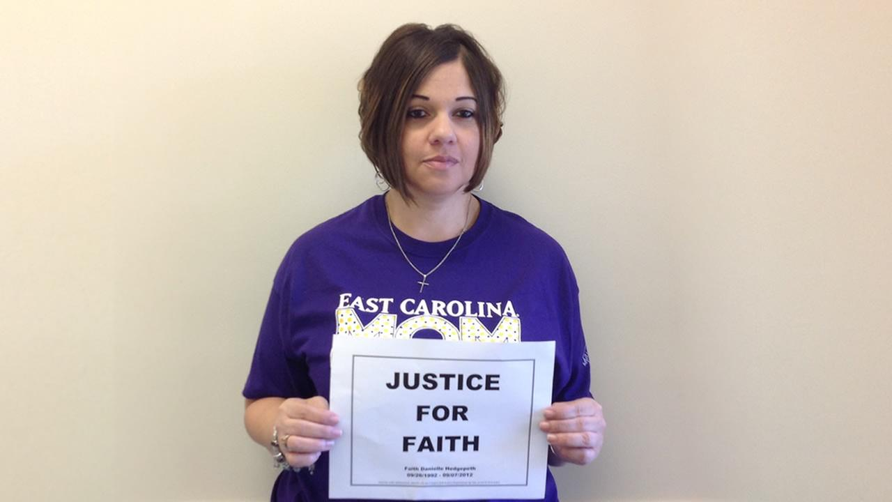 Faiths sister with a Justice For Faith sign.