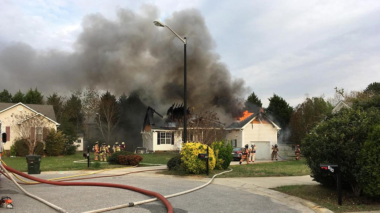 Firefighters work a large fire on Kildaire Court