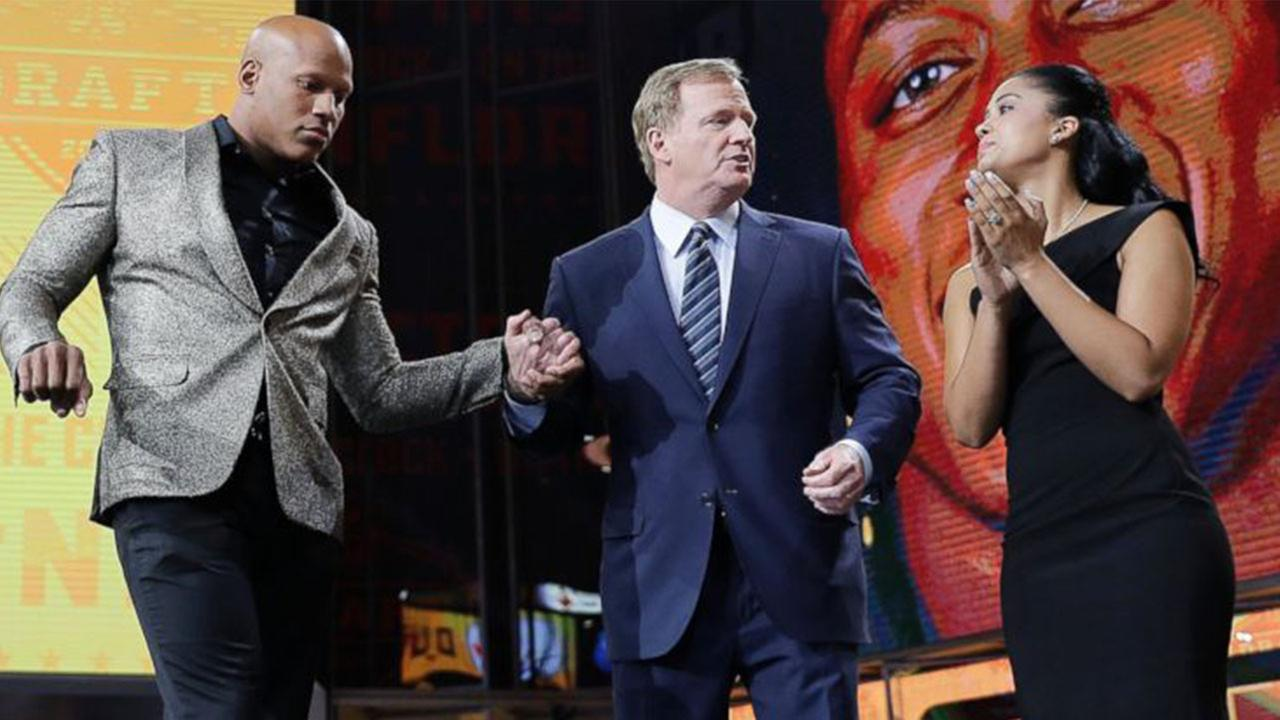 Ryan Shazier, left, and his wife Michelle, right, stand with commissioner Roger Goodell, during the Pittsburgh Steelers selection in the first round of the NFL football draft