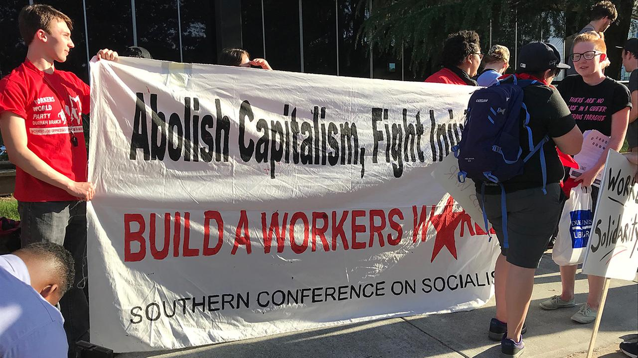 The Durham Workers Assembly and other protesters marched in downtown Durham on May Day to demand higher wages, union rights, an end to ICE raids and evictions.