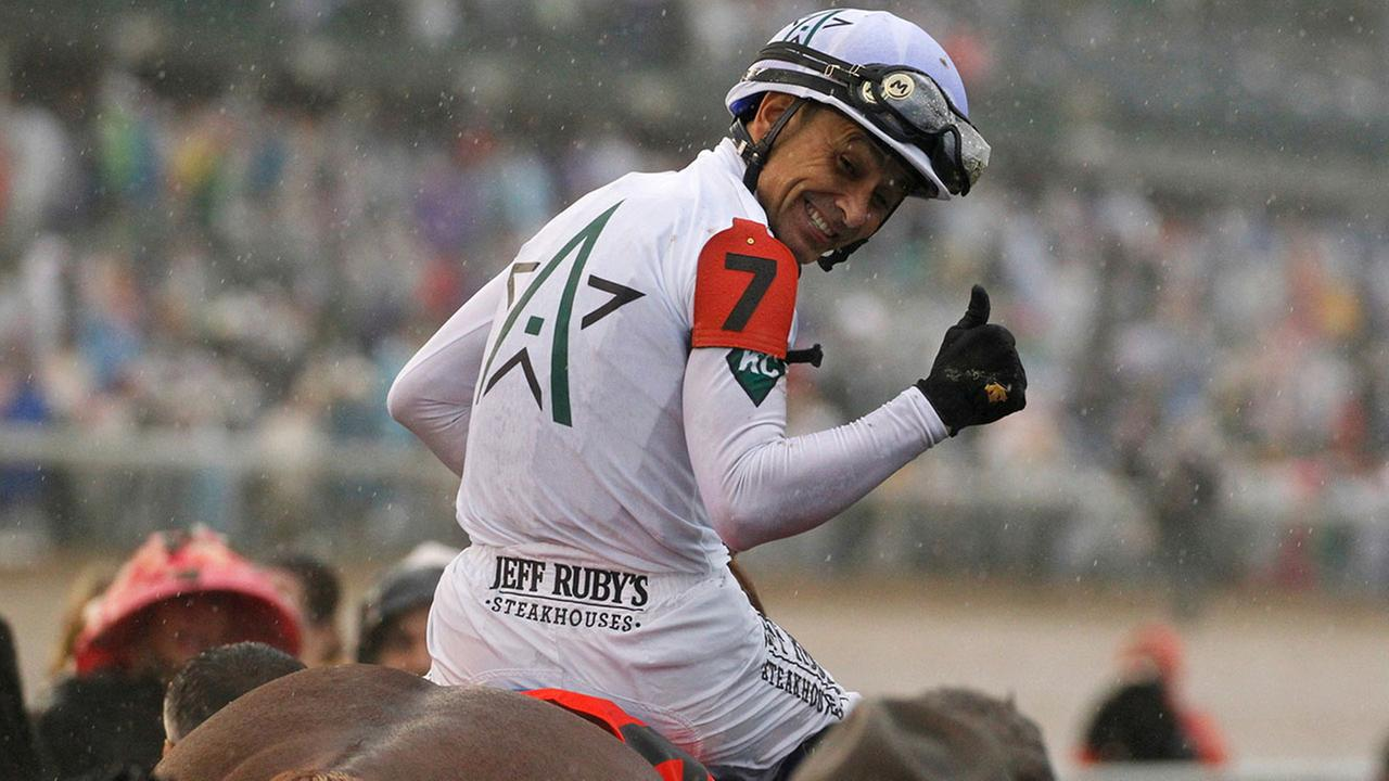 Mike Smith celebrates after riding Justify to victory during the 144th running of the Kentucky Derby horse race at Churchill Downs Saturday, May 5, 2018, in Louisville, Ky.