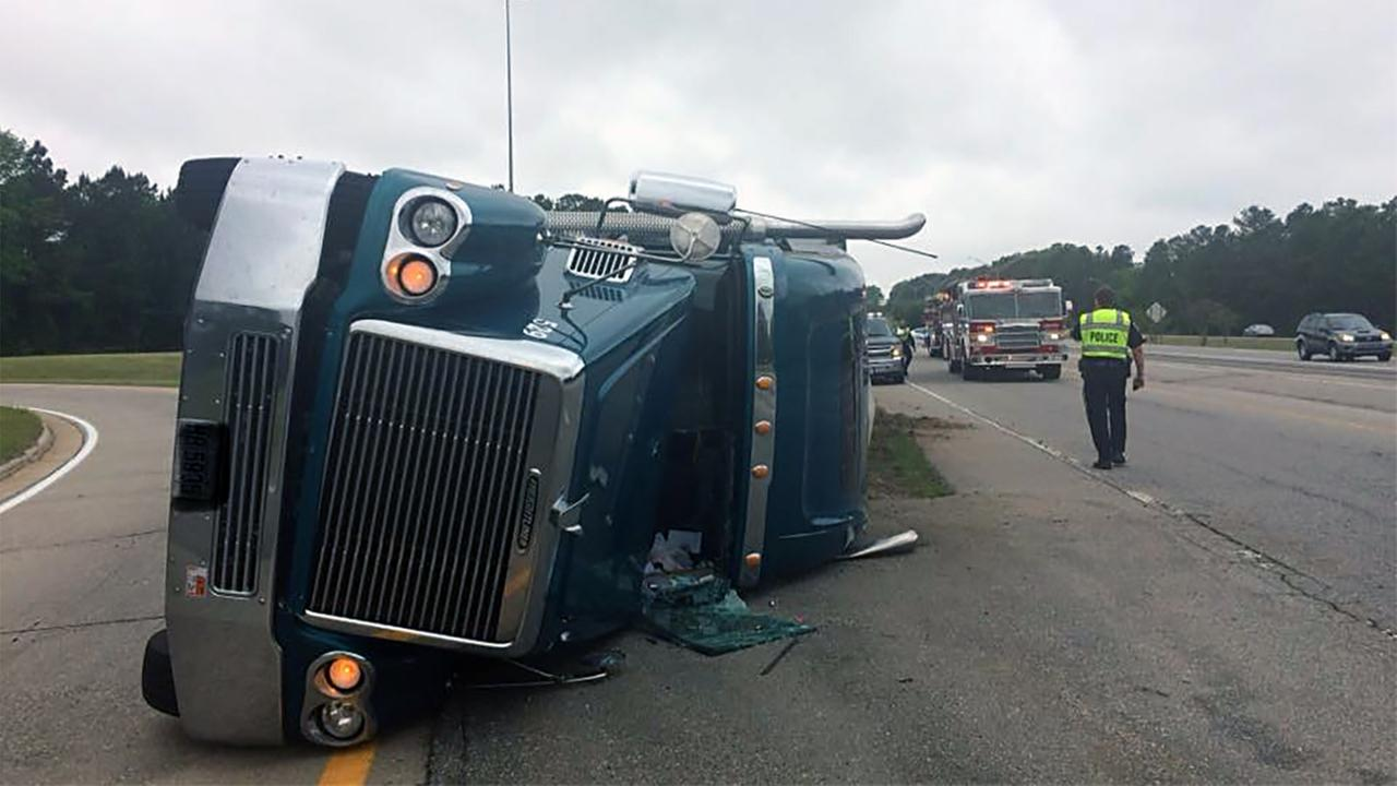 An overturned truck slowed traffic Sunday morning on US 64 near I-95.
