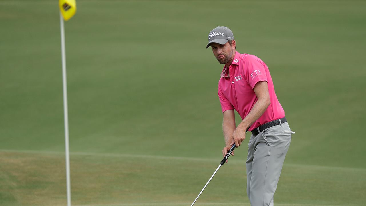 Webb Simpson watches his putt on the eighth green, during the final round of The Players Championship golf tournament.